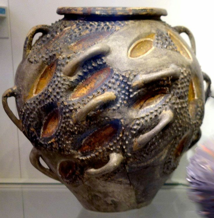 early kamares ware jar with many handles and prickly