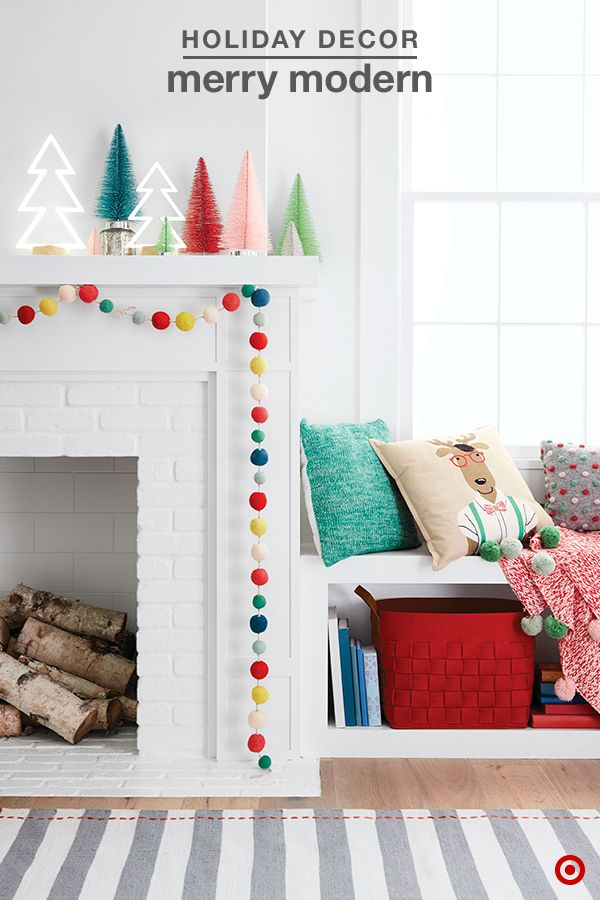 Playful, bright colors and whimsical design add a merry touch to your holiday decorating. Create the merriest mantel with loads of festive colors and modern décor. Mix a variety of textures and finishes for a uniquely festive look. Pom pom garland, bottle brush trees, neon tree lamps and cute decorative pillows are a fun trend this Christmas — have fun with it.