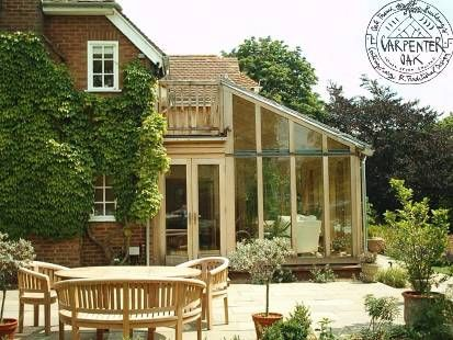 Lean-to Oak frame conservatory with walkway | Carpenter Oak