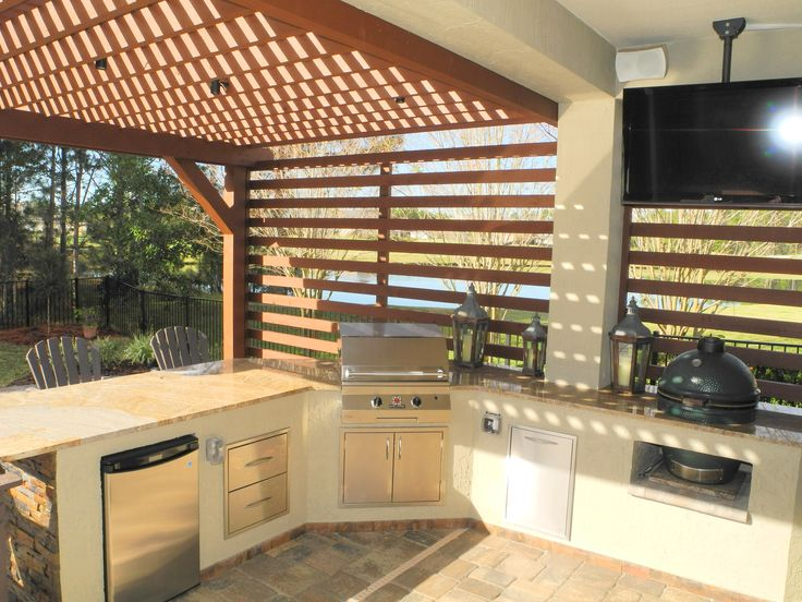 Expand your covered lanai with an attached pergola and add an outdoor kitchen and TV for game day. Designed and constructed by Creative Design Space, Fleming Island FL.