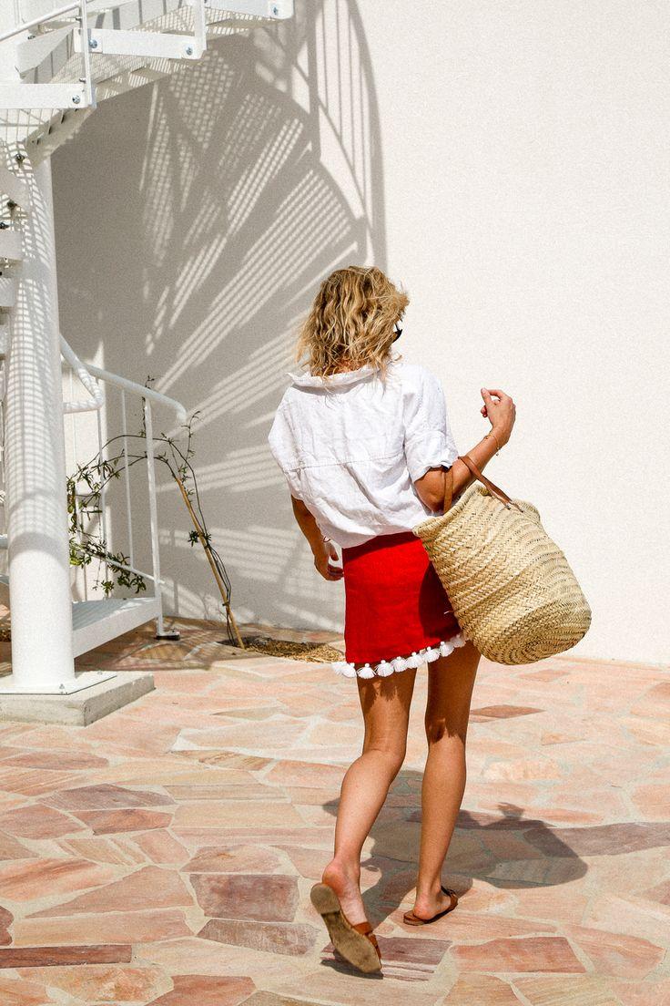 Linen shirt, red skirt, basket bag.