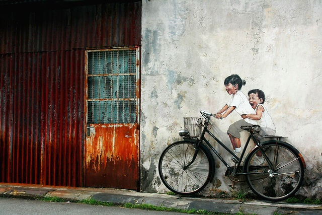 This is Street Art Utopias 1st print in cooperation with the artist and photographer. The print come in different sizes and materials: http://www.bigoom.com/ntgdplqe83h5    In Penang, Malaysia  By Ernest Zacharevic