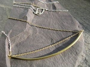 Contrast, golden crescent bar on long chain with 925 silver and golden brass segments
