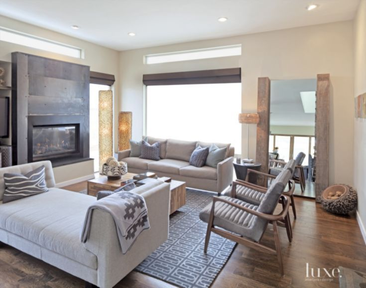 In the living room, designer Caylin Engle arranged the sofa, daybed and a pair of wood and leather chairs, all from Room & Board, around the fireplace. The floor lamps are by Phillips Collection; the mirror and cocktail table are from Environment Furniture in Los Angeles.
