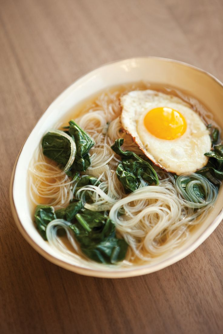 // Spinach noodle soup with fried egg