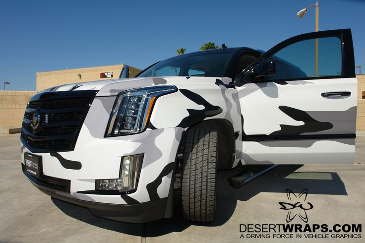 Specialty Camo Wrap on a Cadillac Escalade, designed by DesertWraps.com.  We install vehicle wraps throughout the Coachella Valley and beyond. 760-935-3600