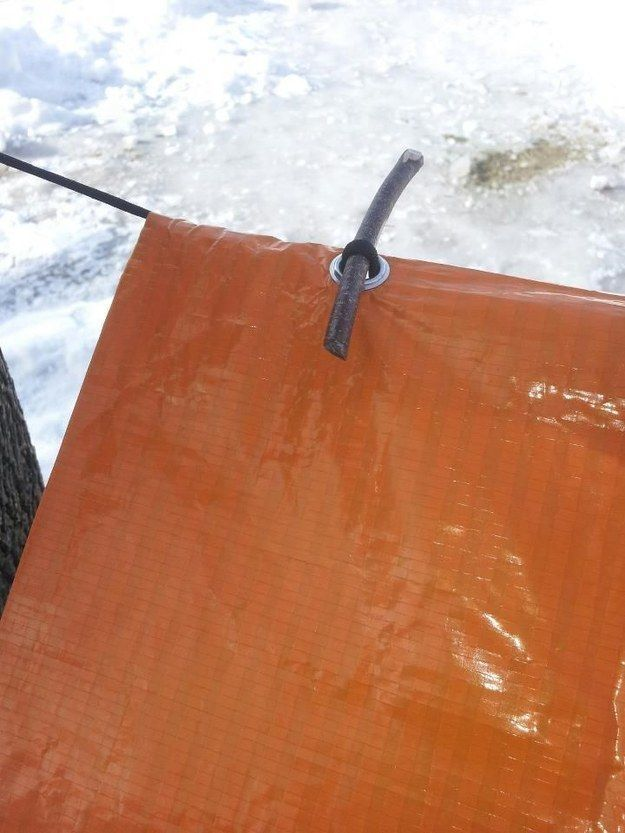 This is the coolest tarp trick: Use a small stick to help secure the main center line. When pressure is put on one end, the line will tighten evenly, keeping the grommets from being torn out. - Camping Hacks