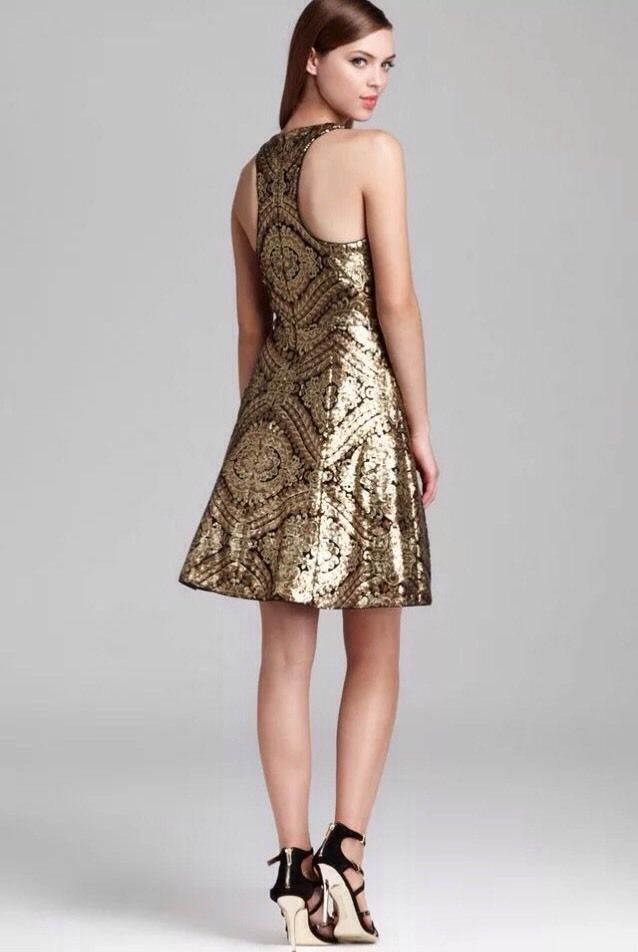 Steal the party in this stunning gold sequin dress. The dress features a racer front and back and an allover exquisite gold sequin design. Fully lined and perfect length, this dress is an eye-catching piece. | eBay!