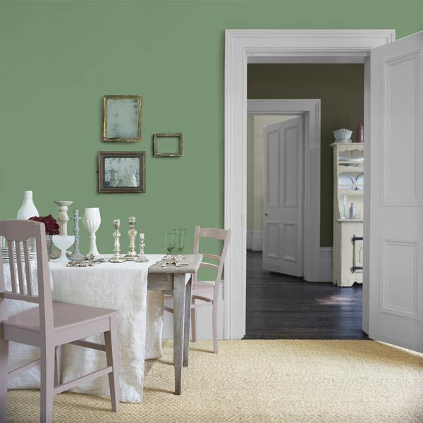 Mismatched picture frames, vessels, and chairs gain a sense of cohesion from Glidden's Sea Glass Green (GLG25). | Photo: Courtesy of Glidden: Green Painted Walls, Pantone Colors, Green Glg25, Hemlock Green, Chocolates Colors, 2014 Pantone, Glasses Green Glidden, Green Glidden Glg25, Gray Chairs