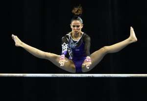 Malaysia's Farah Ann Abdul Hadi competes on the uneven bars during the women's individual all-around gymnastics final at the 28th Southeast Asian Games, in Singapore, on June 8, 2015