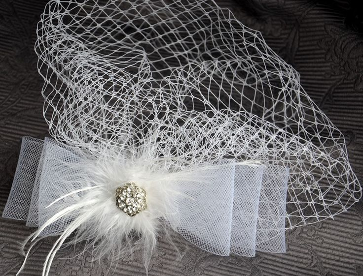 Bird cage veil with bow and crystals