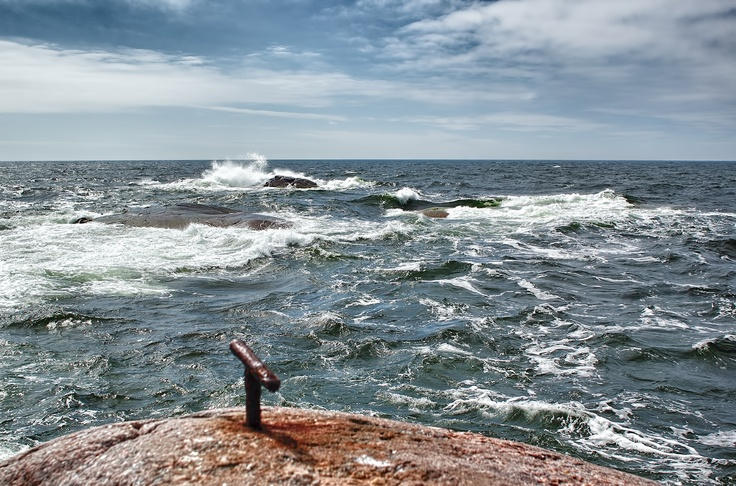 Waves crasch against the shallows outside Bengtskär lighthouse in the gulf of Finland.