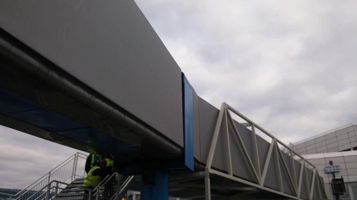 Passenger bridge between airport and plane - refurbished with Stamisol color membrane, beneath Ferrari FT381 / FACID 65 profile system