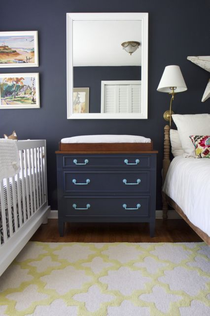 Gender neutral nursery painted Benjamin Moore Hale Navy. Also a great use of space with a crib and a bed!