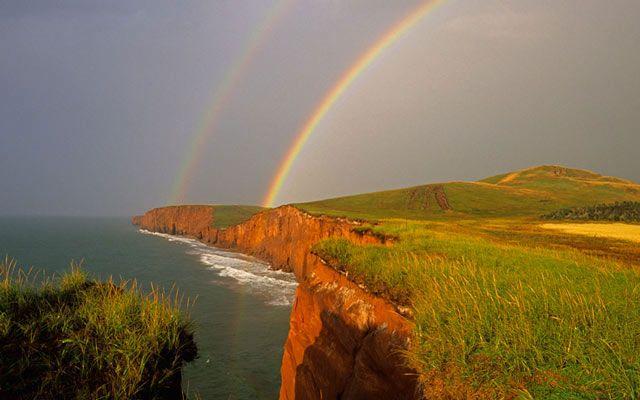 Magdalen Islands, QuebecLovely double rainbow over Cap Herrise on Ile du Cap aux Meules.