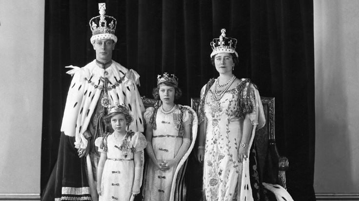 King George VI, Queen Elizabeth, and Princesses Elizabeth and Margaret on the King's coronation day, May 12, 1937. (Credit: Hulton-Deutsch Collection/Corbis via Getty Images)
