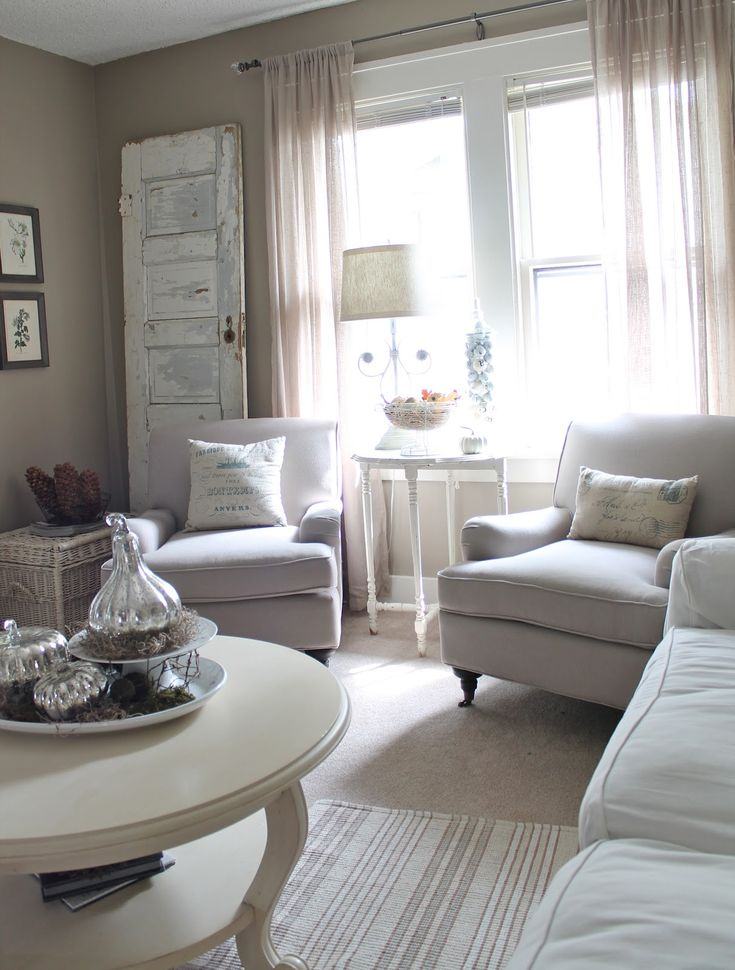 vintage inspired neutral living room, with linen club chairs