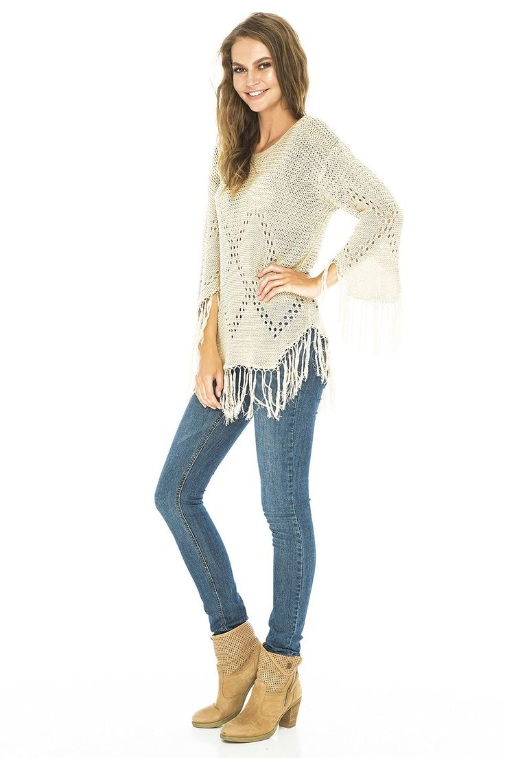 This lightweight, cotton knit sweater transitions easily from winter to spring.  A great mix and match piece.