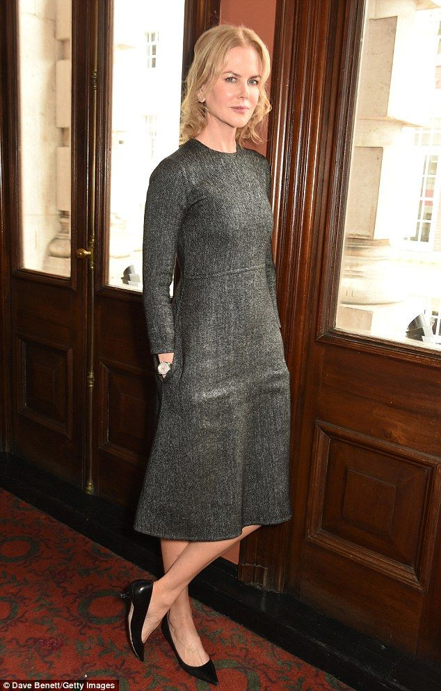 Demure: Nicole Kidman cut a classy - and relaxed - figure as she attended a photocall for the Michael Grandage Company's production of Photograph 51 on Monday