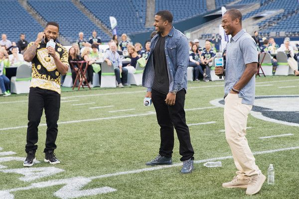 Tyler Lockett Photos - (L-R) Seattle Seahawks players Earl Thomas, Bobby Wagner and Tyler Lockett greet fans at American Express Dinner on the 50 at CenturyLink Field on August 27, 2016 in Seattle, Washington. - American Express Dinner on the 50, August 27 in Seattle
