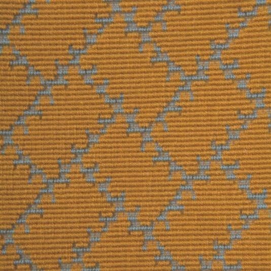 Parterre Fabric Parterre uses a French weaving technique to achieve a tapestry-like fabric, perfect for hardwearing upholstery. Each razor-edged paving stone motif is separated by a grouting-like gully, giving this earthy pattern depth and clarity. Shown in saffron and powder blue.