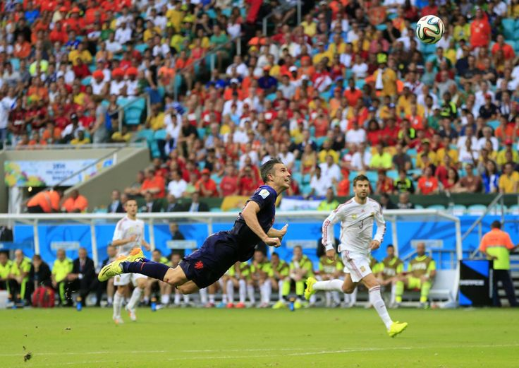 Robin van Persie of the Netherlands scores the teams first goal with a diving header in the first half during the 2014 FIFA World Cup Brazil Group B match between Spain and Netherlands at Arena Fonte Nova on June 13, 2014 in Salvador, Brazil. (Jeff Gross/Getty Images)