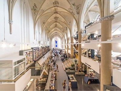 "oh to read here :: 15th century Dutch church converted into 21st century bookstore, where the Dutch have ""smashed together two dying institutions"""