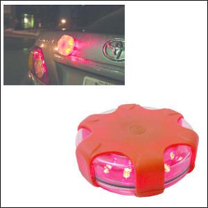 """Beacon Buddy Emergency Roadside Flasher-This flasher beacon is a great addition to your car or boat emergency kit. It is made from ABS Plastic and has 12 powerful red LED lights and two strong magnets on the back. There are 9 different lighting modes to increase your visibility and alert other motorists to your vehicle. Instructions included and individually boxed. Includes 3  AAA"""" batteries (included/not inserted)."""