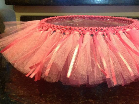 Cake Stand Removable Tutu - BEST IDEA!!! :) Use a stretchable headband to make tutu skirt for cake plate. Can make other cake stands from white plate and candle holder from Dollar Tree. Add lavendar ribbon to this for Rapunzel party!