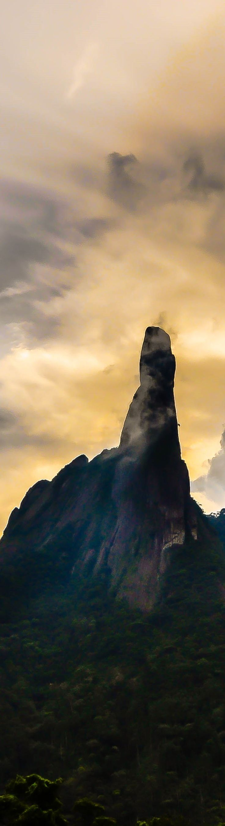 """The Finger of God"" in Teresópolis - Rio de Janeiro.  Finger of God is a peak at 1692 m altitude at the top, and whose outline resembles a hand pointing the finger at the sky. It is one of several geological monuments of the Organ Mountains, a region understood sector of the Serra do Mar - between the cities of Petropolis, Teresopolis Guapimirim and in the state of Rio de Janeiro, Brazil."