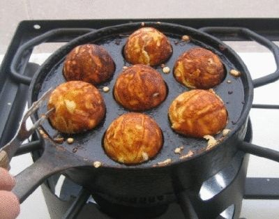 """""""Æbleskiver"""" A danish pan cake specialty. Usually served with jam and powdered sugar at Christmas time."""