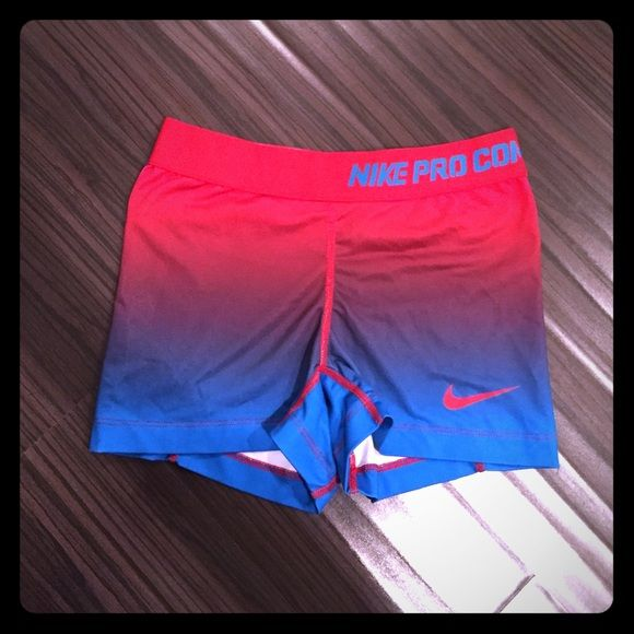 Red & Blue Ombré/Patriotic Nike Pro Combat Shorts Rare Nike Pro Combat shorts. Dri-fit material. Worn only a handful of times; still in good condition. Slight cracking of Nike logo. This is an old style of Nike Pros, so I listed them for higher. Please make your best offer!  Nike Shorts