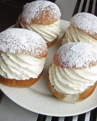 Semla is a Swedish treat. A wheat bun made with cardamom that is sliced in two, filled with almond paste and whipped cream, and dusted with powdered sugar.