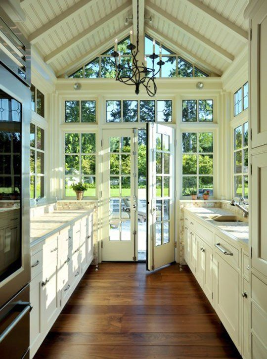 SERIOUSLY my dream kitchen (Well the windows/wall and high ceiling anyways... I would have skylights in it, too.