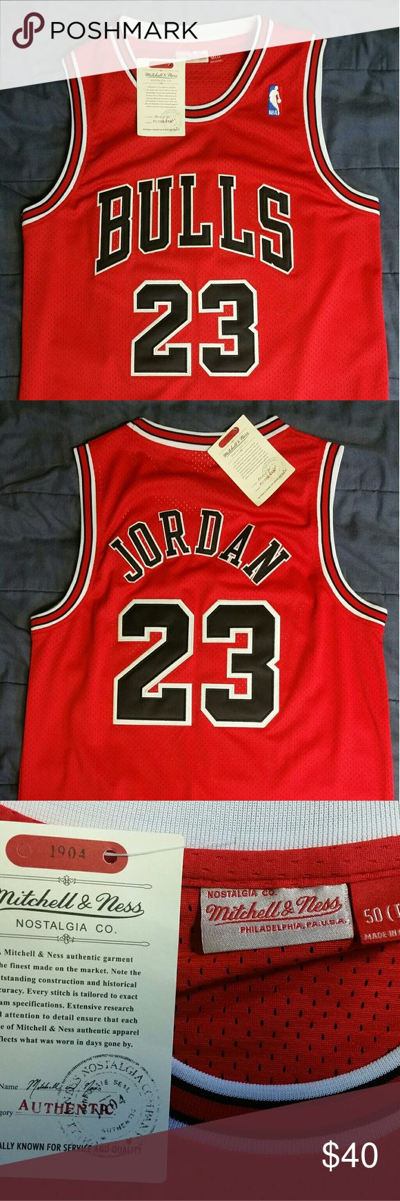 Chicago Bulls Jersey New with Tags Basketball Jersey Chicago Bulls Michael Jordan 23 Mitchell & Ness NBA Large   I take cash, Venmo, or PayPal  If you have any questions, please don't hesitate to ask!   Thanks for looking! Mitchell & Ness Shirts Tank Tops