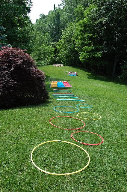 Kid approved obstacle course - hula hoops, pool noodles, slip and slide, PVC arch with plastic chains, jump into pool