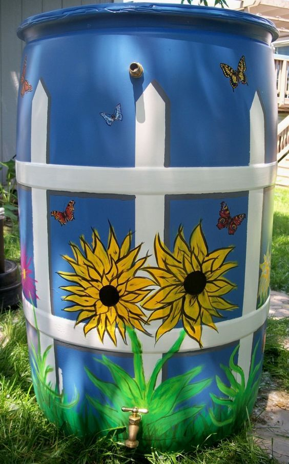 paint rain barrels for yard... Krylon Fusion spray paint for base, then acrylic for design: