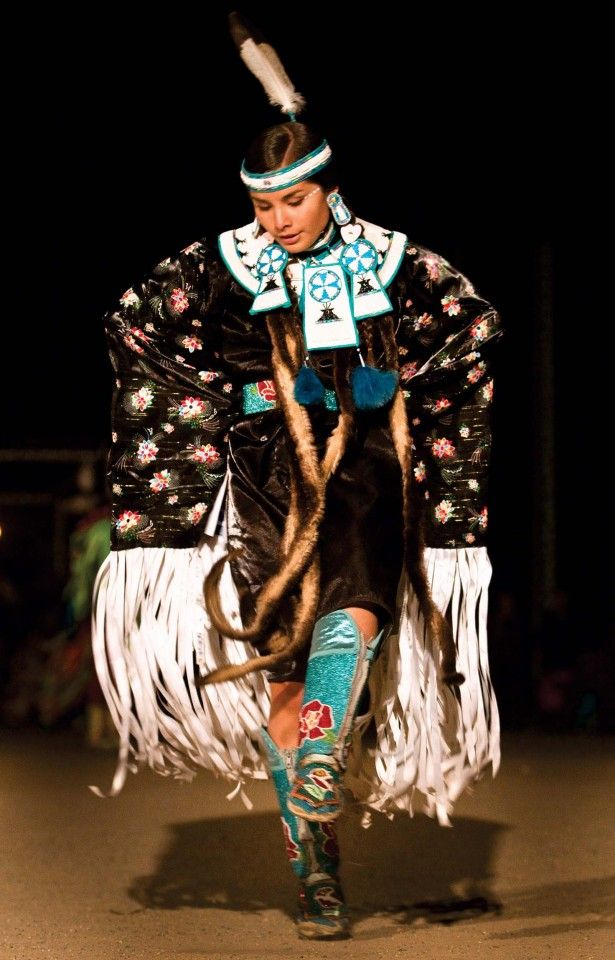 Valerie Adrian, Oglala Lakota/Coeur d'Alene, of Washington state performs on Saturday night, Oct. 6, during the 101st Annual Northern Navajo Nation Fair Contest Powwow in Shiprock, NM.