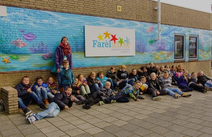 Muurschildering school oceaan vissen