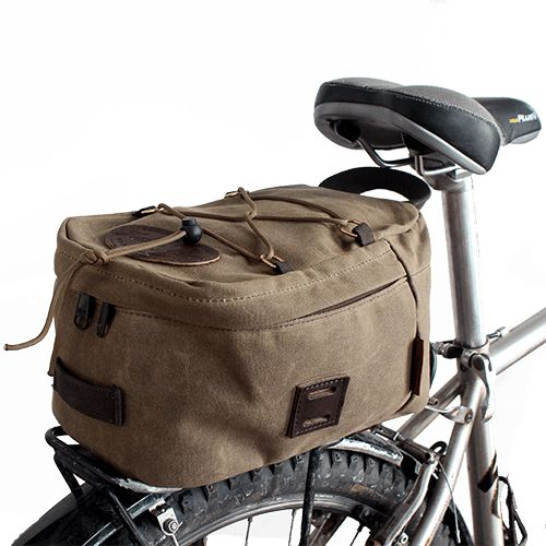 A mostly-padded waxed canvas bag that mounts to a bike rack. Keep your junk in a trunk on a bike.