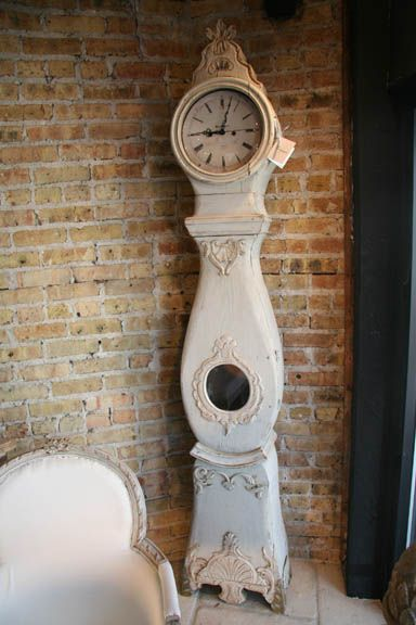 1760 Antique Gustavian Swedish Mora Clock in Traditional Milk Paint Finish. This extremely old clock is operational with a quartz movement and the Roman numeral clock face is a reproduction. Nonetheless, still simply elegant and gorgeous!