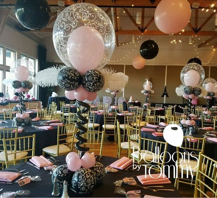 Pink and black balloon centerpieces for a