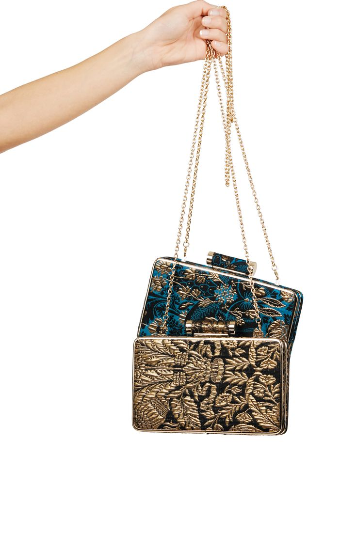 This season let your handbag do the talking with our luxurious jacquard box clutch, inspired by the iconic Warner Textile Archive.