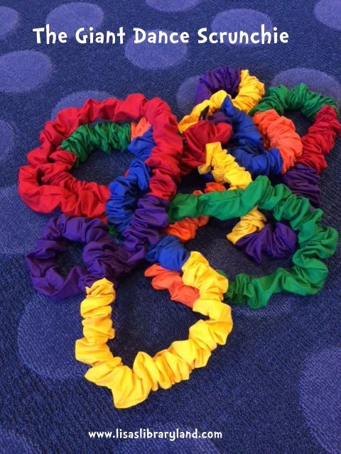 Once upon a time, I attended a Jim Gill early childhood workshop and he brought out a giant dance scrunchie.  He showed off how he used his ...