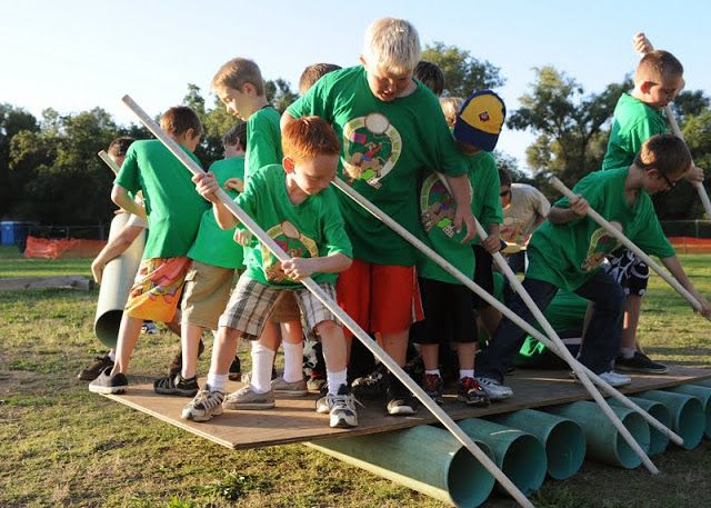 """team building activity where the boys have to work together to move the """"boat"""""""
