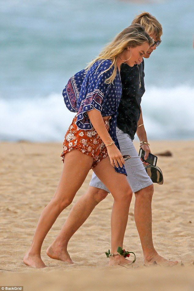 Beach chic: The Wolf Of Wall Street star offered a glimpse of her tummy in a boho wrap top...