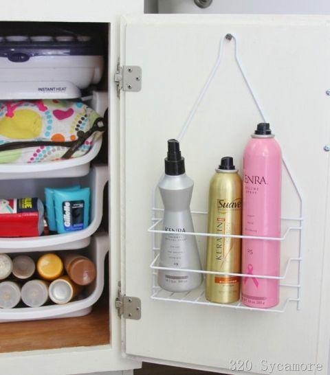 hairspray on a shower caddy attached to the back of your bathroom