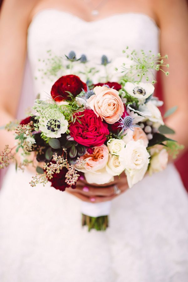 Southern bride Kristen carried a bouquet of garden roses, anemones, thistles, and Queen Anne's lace. | Photo by Crystal Stokes