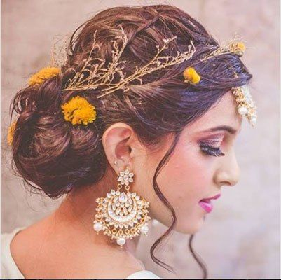 Pretty bride with boho bun hair style with a fresh flowers | The ultimate guide for the Indian Bride to plan her dream wedding. Witty Vows shares things no one tells brides, covers real weddings, ideas, inspirations, design trends and the right vendors, candid photographers etc.| #bridsmaids #inspiration #IndianWedding | Curated by #WittyVows - Things no one tells Brides | www.wittyvows.com