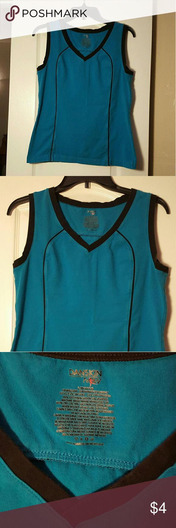 Danskin teal shirt Danskin teal with black trim shirt 95% cotton 5% spandex used condition but lots of exercise stretch left in it. Size Lg.  12/14 Danskin Now Tops